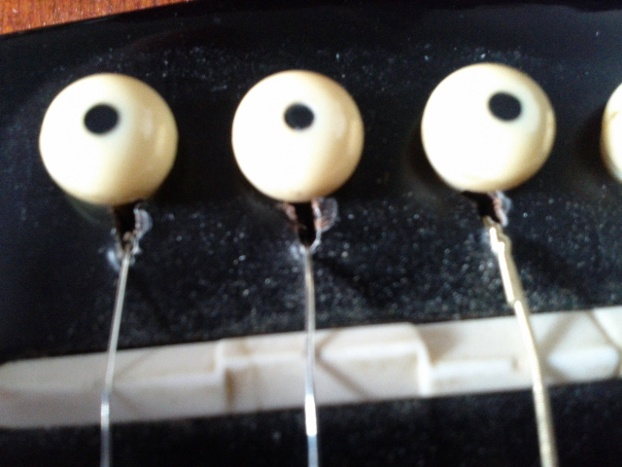 acoustic guitar bridge erosion